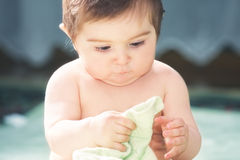 Cute baby playing with towel Stock Photos
