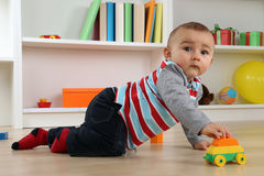 Cute baby playing with toy car Royalty Free Stock Images