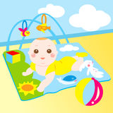 Cute baby playing toy happily Royalty Free Stock Photos