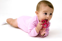Cute Baby Playing with Toys Stock Photo