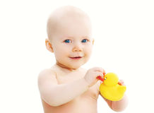 Cute baby playing with yellow rubber duck Stock Images