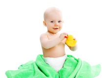 Cute baby playing with yellow rubber duck Royalty Free Stock Photos
