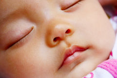Cute baby portrait. It is a cute chinese baby, isolated. he is 5 months Royalty Free Stock Photos