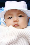 Cute baby portrait. It is a cute chinese baby, isolated. he is 5 months Royalty Free Stock Photo
