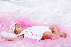 Cute baby portrait. Cute baby sleeping with a monkey Stock Image
