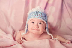 Cute baby portrait dressed in blue hat Stock Photography