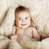 Cute baby portrait lying on fur Stock Images