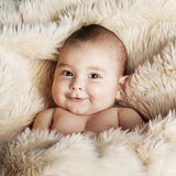 Cute baby portrait lying on fur Royalty Free Stock Images