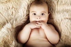 Cute baby portrait lying on fur Stock Photo
