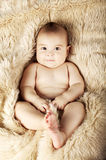 Cute baby portrait lying on fur Stock Image