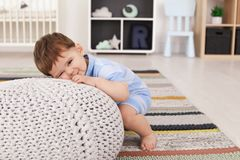 Cute baby with pouf at home. Learning to walk royalty free stock photo