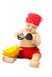 Cute baby putting on sunglasses Stock Photo