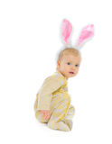 Cute baby with rabbit ears sitting on floor Royalty Free Stock Photos