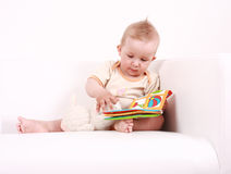 Cute baby reading Royalty Free Stock Photo