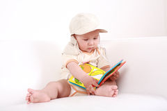 Cute baby reading Stock Photos