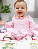 Cute baby reading stock photography