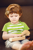 Cute baby reading a book. Royalty Free Stock Photography