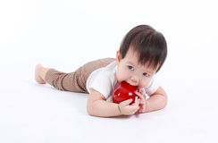 Cute baby with red apple (eating healthy food) Stock Images