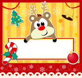 Cute baby reindeer. With blank board and christmas decoration Royalty Free Stock Photo