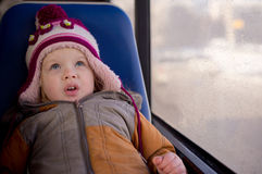 Cute baby riding bus look upside Royalty Free Stock Images