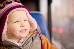 Cute baby riding bus on seat place Royalty Free Stock Photography