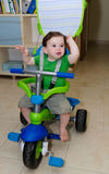 Cute Baby riding a tricycle Royalty Free Stock Images