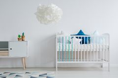 Cute baby room. Cute, pastel baby room with stylish set of furniture stock images