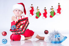 Cute baby Santa Claus with Christmas toys Royalty Free Stock Photography