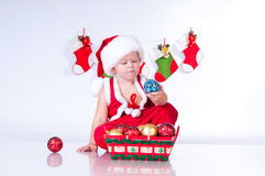 Cute baby Santa Claus with toys. Stock Image