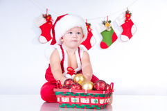 Cute baby Santa Claus with toys. Stock Photos