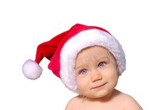 Cute Baby in Santa Hat. Cute baby wearing a santa hat and holding a green holiday light Stock Photography