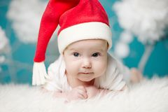 Cute baby in Santa hat Stock Images
