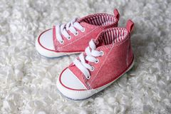 Cute baby shoes. On soft plaid Stock Photography