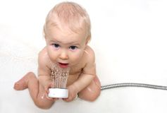 Cute baby with shower stock photography