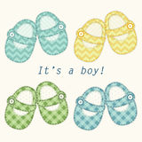 Cute baby shower card with baby shoes as retro fabric applique in shabby chic style Stock Images