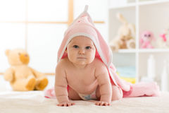 Cute baby after shower with towel on head stock photography