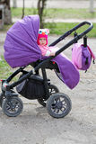 Cute baby sitting in the stroller Royalty Free Stock Photo