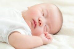 Cute baby sleep. Lying on bed stock photography