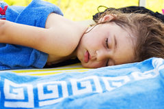 Cute baby is sleeping on the beach at summer day, Royalty Free Stock Images
