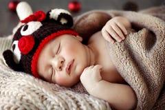 Cute baby sleeping in Christmas pajamas Stock Image