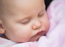 Cute baby sleeping with eyes closed Stock Images