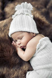 Cute baby sleeping on the fur Stock Images