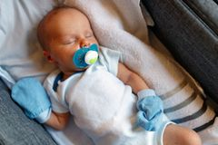 Cute baby sleeping at home in crib stock photos