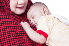 Cute baby sleeping on mother's chest Stock Photos