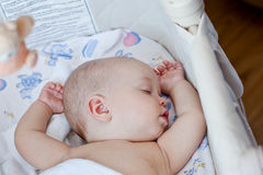 Cute baby sleeping sweetly in the cradle Royalty Free Stock Photos