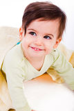 Cute baby smile under yellow blanket Stock Images