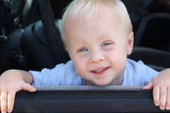 Cute Baby Smiling from Car Window Royalty Free Stock Image