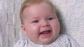 Cute baby smiling happily stock footage