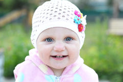 Cute baby smiling portrait in white knitted cap Royalty Free Stock Photos