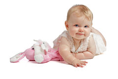 Cute baby smiling in sleeveless sundress Stock Photo